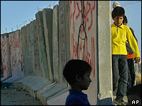 Children play along a section of the barrier in east Jerusalem