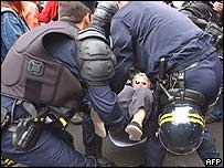 Police carry away a demonstrator in front of the court on Wednesday
