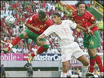 Ronaldo (left) heads Portugal into the lead