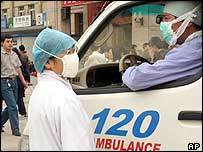 Chinese health workers in Beijing, 7/05/04
