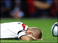David Beckham lies face down on the turf