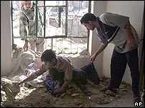 Falluja residents shift through debris after a US missile strike