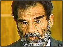 Saddam Hussein appears before the special tribunal in Iraq