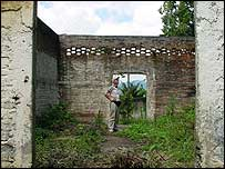 Mike Lanchin inspects the former dormitory where he was a coffee picker in the 1980s