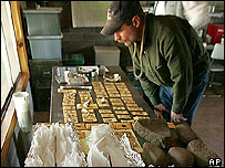 A journalist looks at arrowheads, beads and pottery pieces and other remains