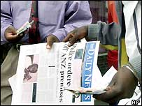 A vendor selling the Zimbabwean newspaper Daily News