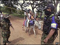 Paramilitary fighters man a roadblock in north-eastern Colombia