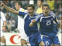 Traianos Dellas (left) celebrates his winner with Costas Katsouranis