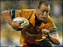 Australia centre Stirling Mortlock powers his way to the first try against the Islanders