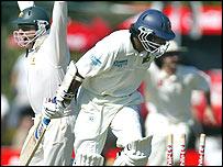 Sri Lanka's Kumar Sangakkara falls as Darren Lehmann celebrates