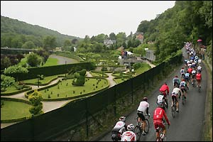 The cyclists pass a topiary elephant as they ride out of Durbuy