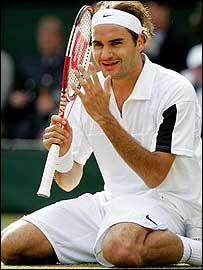 Roger Federer celebrates his Wimbledon victory