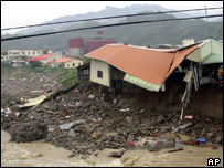 House affected by flooding in the town of Miaoli, Taiwan, 5 July 2004