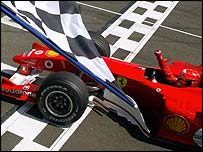 Michael Schumacher takes the chequered flag at the French Grand Prix