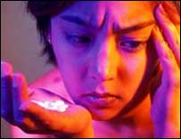 Depressed girl with tablets