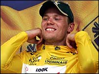 Thor Hushovd celebrates claiming the yellow jersey