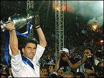 Greece captain Theodoros Zagorakis shows off the Euro 2004 trophy to thousands of fans gathered in the old Olympic stadium in Athens