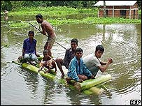 Locals escape flooding in India's north-eastern Assam state