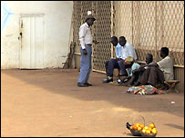 Men sitting on a street of Bangui, capital of Central African Republic