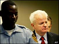 Slobodan Milosevic appears under guard at The Hague, July 2004