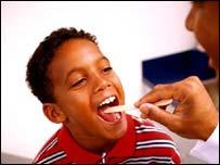 GP examining child