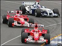 The Ferraris of Michael Schumacher and Rubens Barrichello lead Juan Pablo Montoya at the Australian Grand Prix this year
