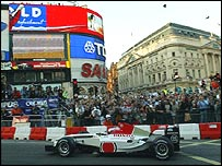 Jenson Button guides his BAR through Piccadilly Circus on Tuesday