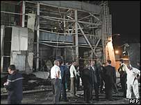 Officials gather at the scene of June's explosion at the Hamma power plant