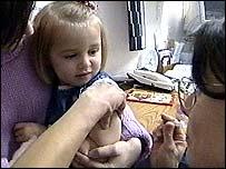 Girl receiving MMR vaccine
