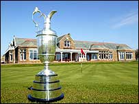 The Claret Jug with Royal Troon's clubhouse in the background