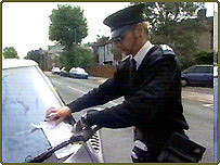Traffic Warden giving out parking ticket