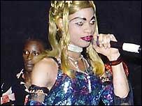 Amanda, lead member of Amanda's Angels, a group of erotic dancers