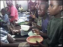 Zimbabwean children receiving food aid