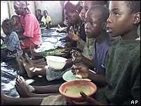 Zimbabwean children receiving food aid