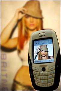 Mobile phone with image of Britney Spears (Courtesy Vismedia)