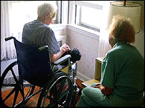 Man in wheelchair in care home