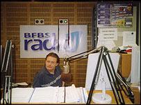 BFBS DJ Jamie Gordon in studio in Herford