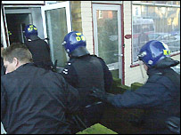 Officers raid an address