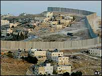 Palestinian houses are seen on both sides of Israel's separation barrier in the West Bank village of Abu Dis, on the outskirts of Jerusalem