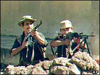 Guerrilla fighters attacking San Salvador in 1989