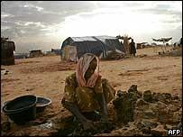 Darfur refugee making bricks