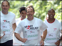 Sir Steve Redgrave (left) and Colin Jackson keep pace with Prime Minister Tony Blair