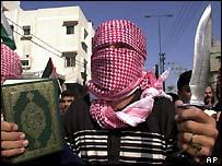 Palestinian militant holding the Koran
