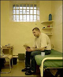 A prisoner reads in his cell at Dartmoor prison