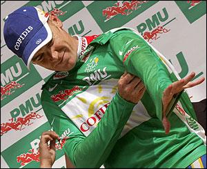 Stuart O'Grady pulls on the green jersey