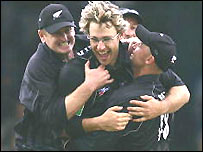Vettori is mobbed by team-mates