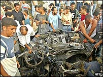 Wreckage of a car after it exploded in Gaza