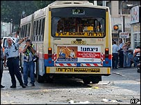Bus with windows blown out at scene of blast