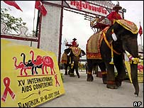 Elephants parade at the opening of the 15th International AIDS Conference in Bangkok