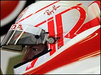 Jenson Button displays his new helmet at the British Grand Prix